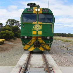 coupled-in-motion rail car weighing